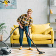a woman cleaning using vacuum