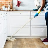 Person cleaning a wood flooring