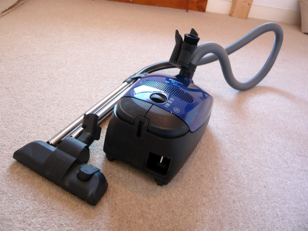 a black and blue vacuum