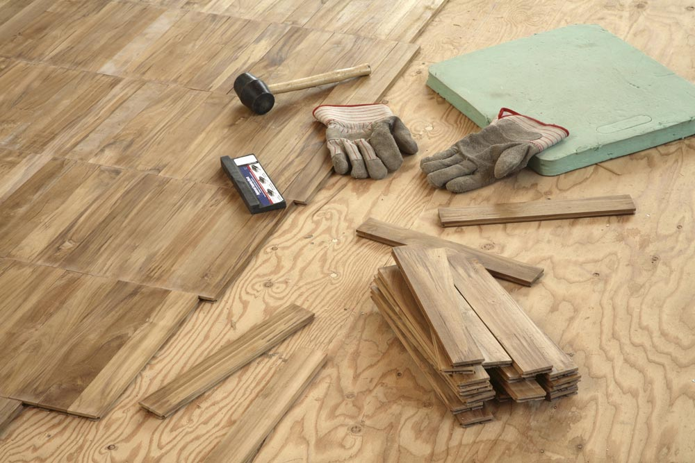 unfinished hardwood flooring and tools used to install hardwood tiles