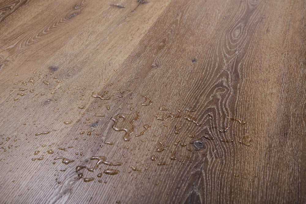 a hardwood flooring with some drops of water