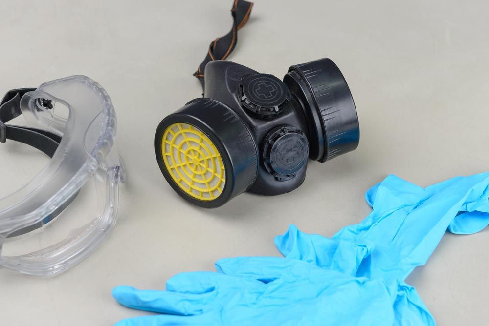 safety glasses, respirator mask and latex gloves